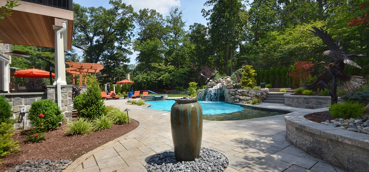 Beautiful Backyard with Hardscaping Elements Pool ,Retaining Wall, Pool Deck, Steps, Waterfall