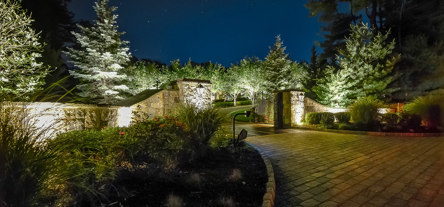 Landscape Lighting at Gorgeous Pillared Driveway Entrance