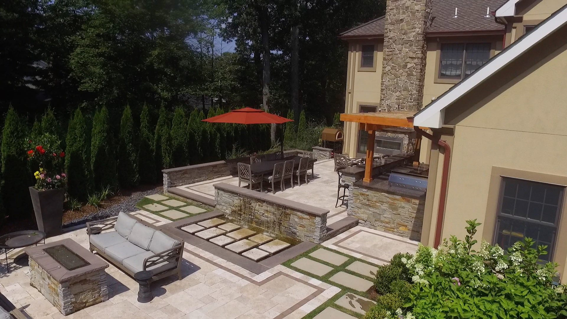 Outdoor Kitchen, Bar, Dining, and Seating with Firepit