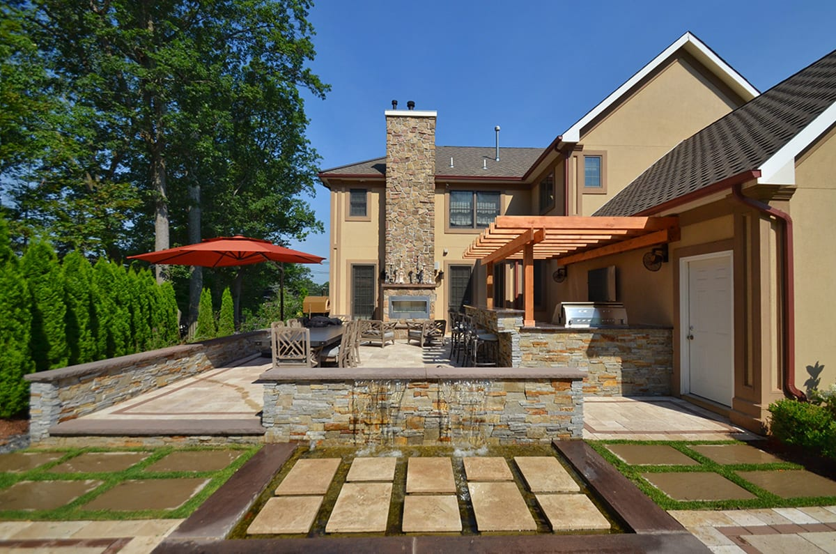 Outdoor Kitchen, Dining, Fireplace and Waterfall