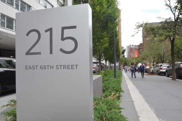 215 E 68th Street view with sign
