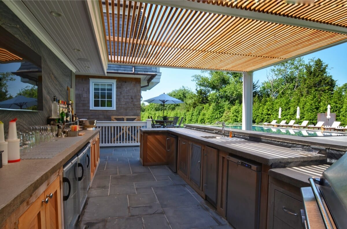 Outdoor Kitchen and Bar with Cedar Wood Cabinets and Pergola