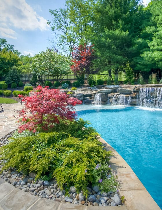 Residential Landscaping by Sponzilli Pool Waterfall and Gardens