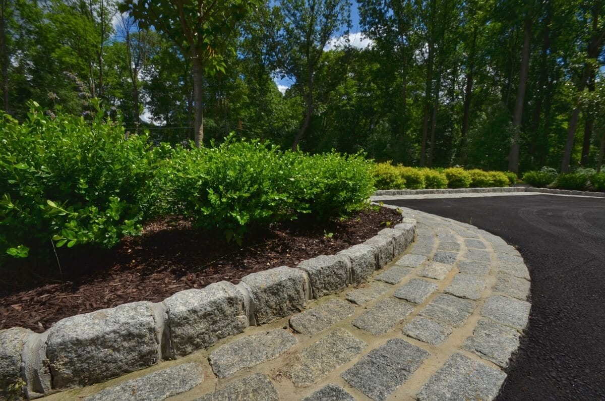 Driveway with stone inlay and curbing