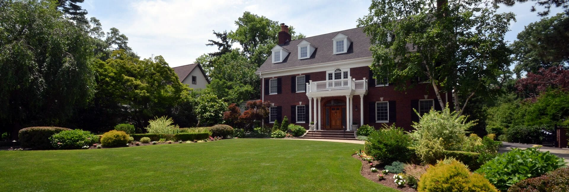 Brick Georgian Style Home with Nice Landscaping