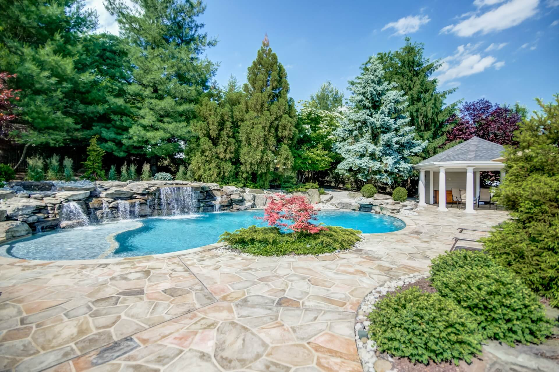 Pool with waterfalls and beautiful stone deck