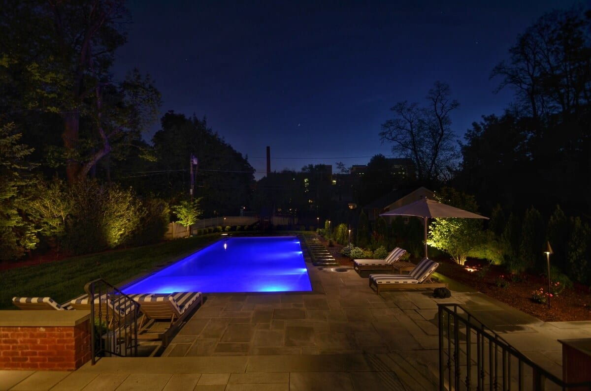 Night view of pool from raised terrace