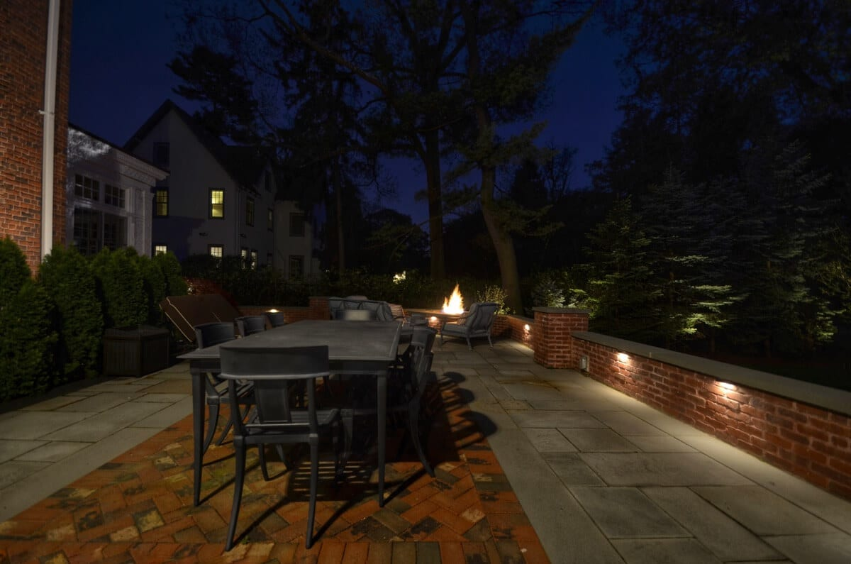 Expansice Bluestone and Brick Terrace at Night with Lishting
