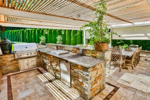 Pergola with Elegant Outdoor Kitchen, Dining, and Bar