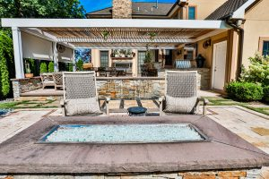 Outdoor Living Space with Water Feature and Fireppit