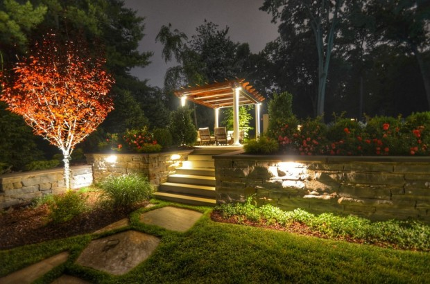 Beautifully Lit Raised Terrace with Pergola and Gardens