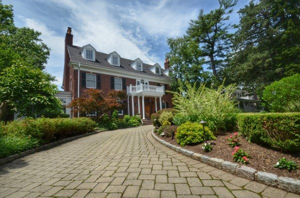 Driveway with Belgium Block Curbing Leads to Nice Brick Home