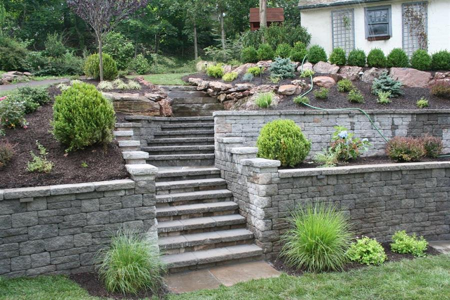 Hardscaping sponzilli landscape group for Rock stepping stones landscaping