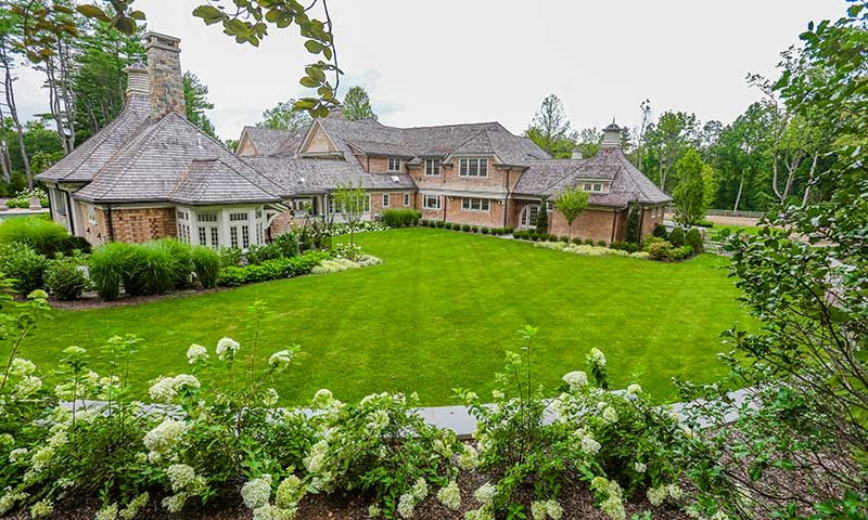 Beautiful back yard with lush grass and landscaping