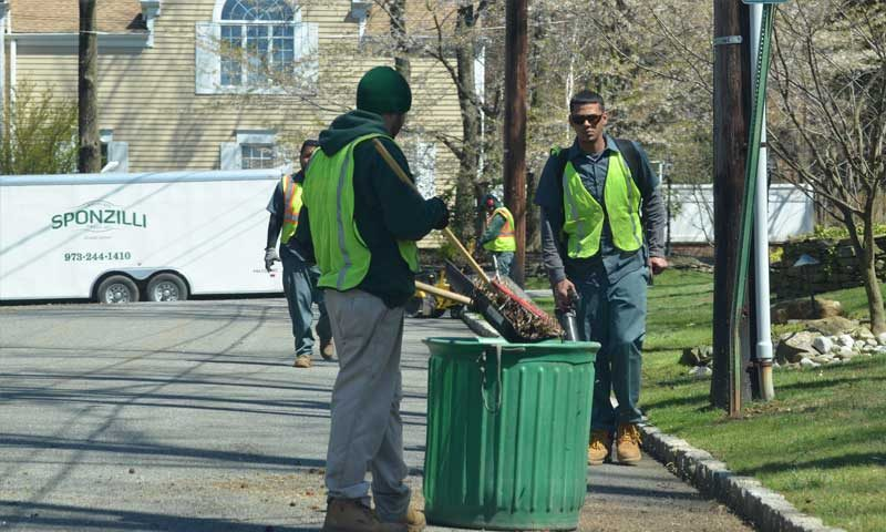 Landscapers doing seasonal cleanup