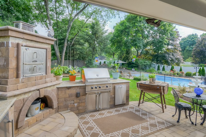 Outdoor Kitchen with Pizza Oven, Grill, and Refrigerator