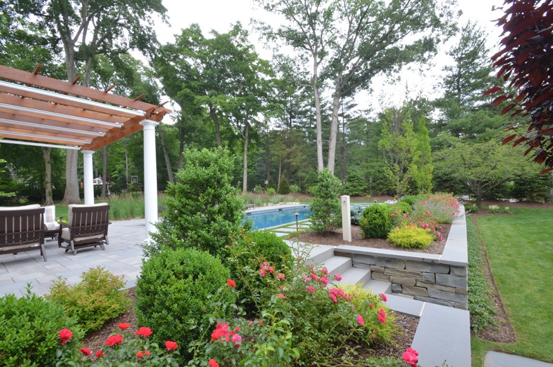 Raised Pergola surrounded by Pool and Gardens