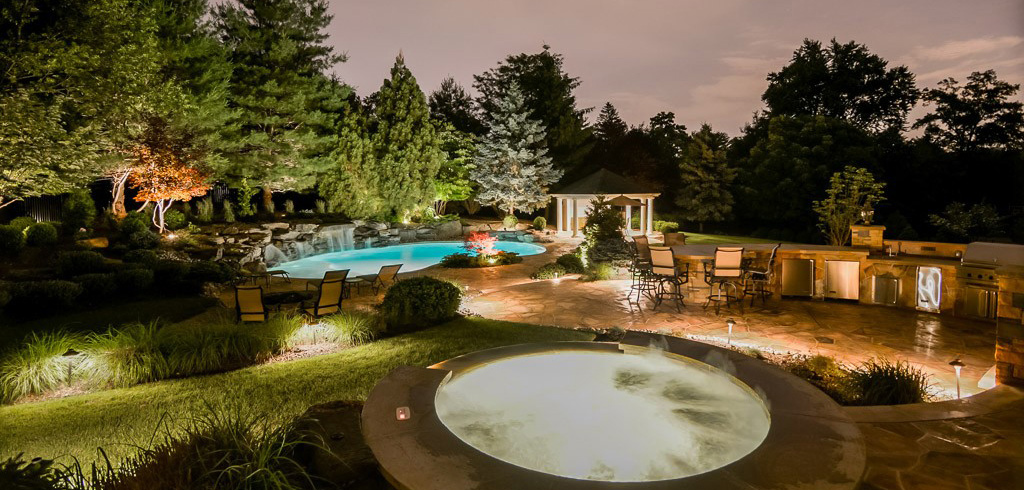 Landscape Lighting Techniques Highlight Pool, Jacuzzi, Patio, Outdoor Kitchen, and Pergola