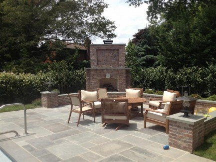 Outdoor Living Space with Fireplace and Paver Patio