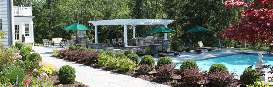Swimming Pool with Pergola and Outdoor Kitchen Area