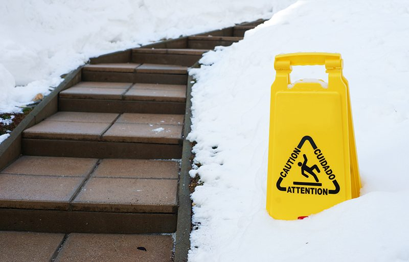 Slippery steps with Caution sign