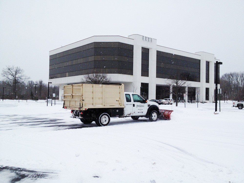 Snow Plowing a Corporate Parking Lot