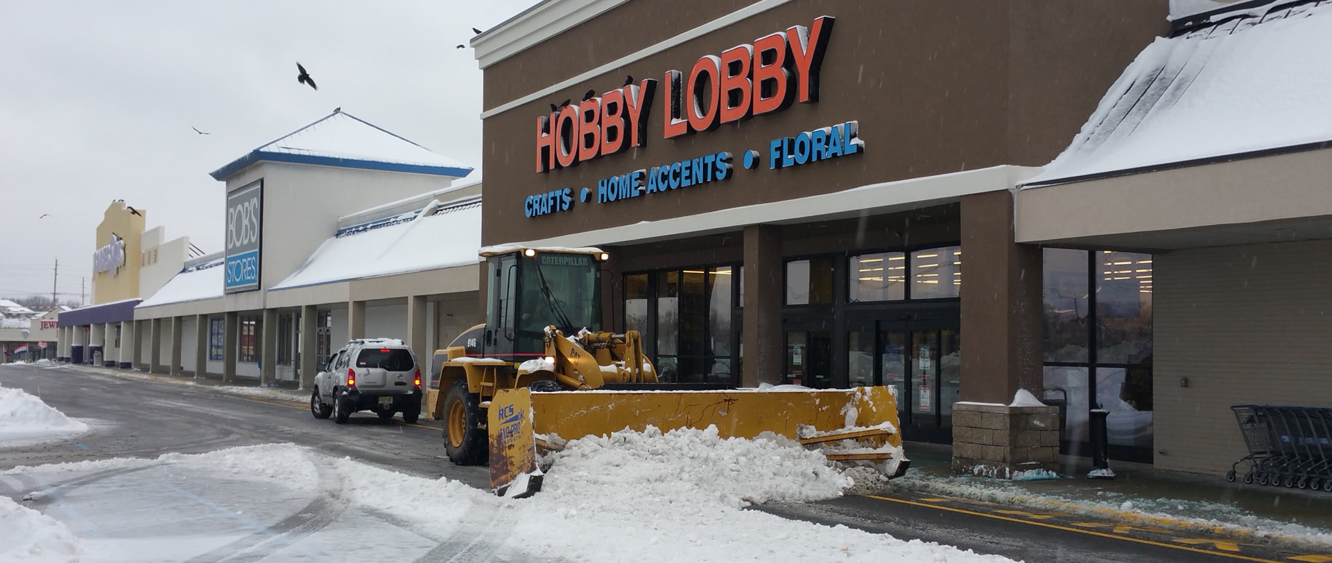 Snow Plowing in Hobby Lobby Parking Lot